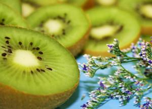 Free Pretty Green Kiwi Fruit on Aqua with Little Flowers Creative Commons